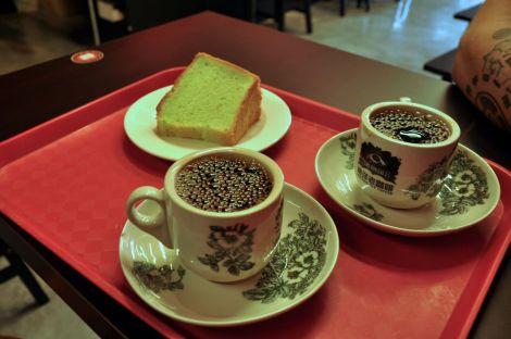 Kopi, Singaporean coffee, served with green tea cake