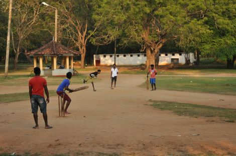 Cricket game near Kataragam Temples. Sri Lanka